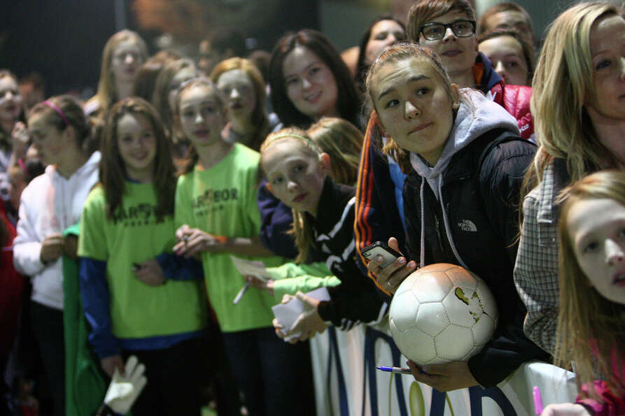 Fans wait for Seattle Sounders player Hope Solo to sign autographs during the Sounders women season