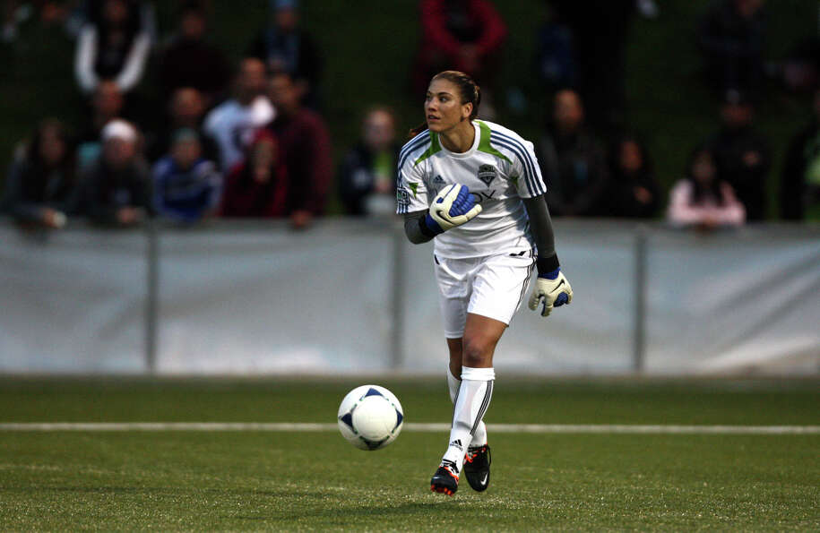 Seattle Sounders women player Hope Solo puts the ball into play against Seattle Pacific University d