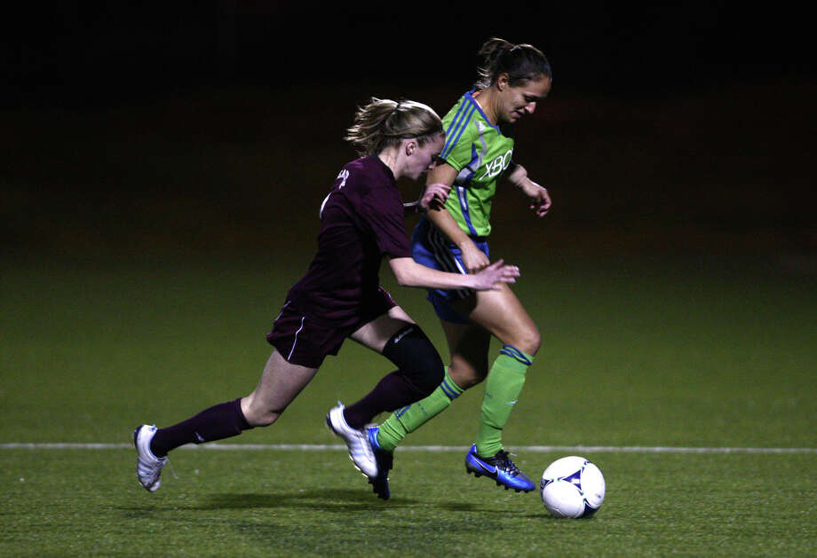Seattle Sounders women player Stephanie Cox treis to keep the ball from Seattle Paific University player Riley Dopps during the Sounders season opener on Monday, April 9, 2012 at Starfire Sports Stadium in Tukwila. Photo: JOSHUA TRUJILLO / SEATTLEPI.COM