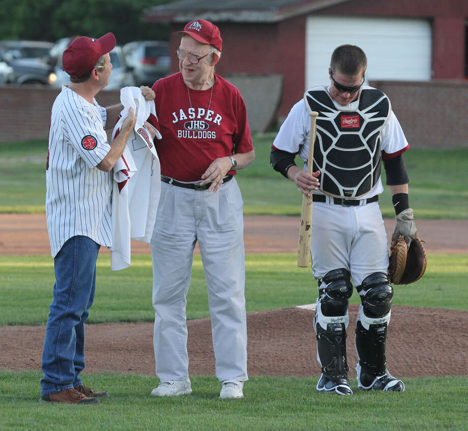 In pre-game ceremonies, Shawn Johnston was presented with an retired Jasper baseball jersey and an autographed bat for his attendance at Jasper sports contests. Photo: Jason Dunn
