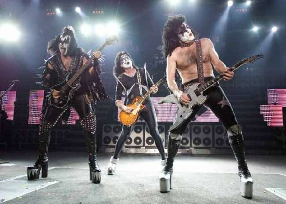 The rock band Kiss, from left, Gene Simmons, Tommy Thayer and Paul Stanley perform during their performance at the PNC Bank Arts Center in Holmdel, N.J. on Tuesday, July 20, 2004. (AP Photo/Christopher Barth) (AP)