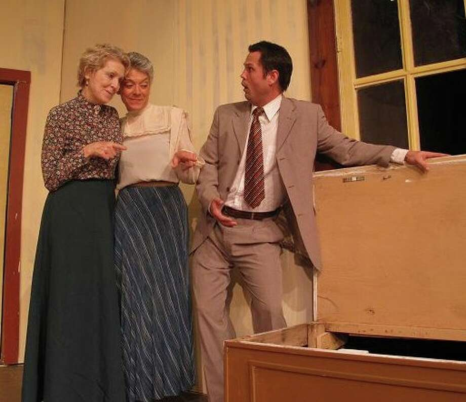 "Aunt Martha and Aunt Abby (Ryla Wolfe, left, and Donna Griffin) explain the body in their window seat to their nephew Mortimer (Randy Foerster) in the Circle Arts Theatre's staging of ""Arsenic and Old Lace."" Photo: Circle Arts Theatre"