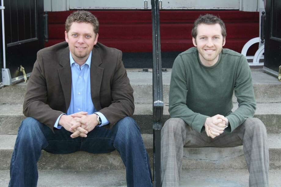 Landon Reesor (left) and Chad Wade (right) sit outside the Calvary Baptist Church in Darien where they hold meetings and services for Encounter Church. The church, which was founded by Reesor, was created to strengthen the relationship between God and his worshipers. Photo: Ben Holbrook