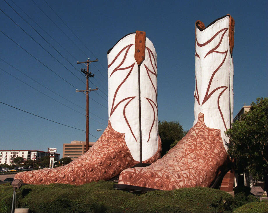 """Giant Justins,"" 40-foot tall boots at North Star Mall built in New York City in the late 1970s by Bob ""Daddy-O"" Wade and moved to Texas in 1980. Also: Government Canyon State Natural Area, Government Hill Historic District, Guadalupe Cultural Arts Center/Guadalupe Theater, Guenther House and ghost tracks. Photo: KIN MAN HUI, Staff Photographer"