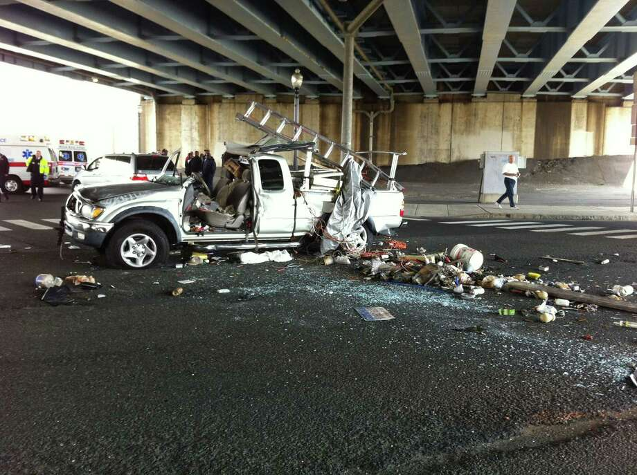 A pickup truck was mangled Tuesday, April 10, 2012 in an accident underneath the Interstate 95 overpass near exit 29 in Bridgeport, Conn. Photo: Brittany Lyte
