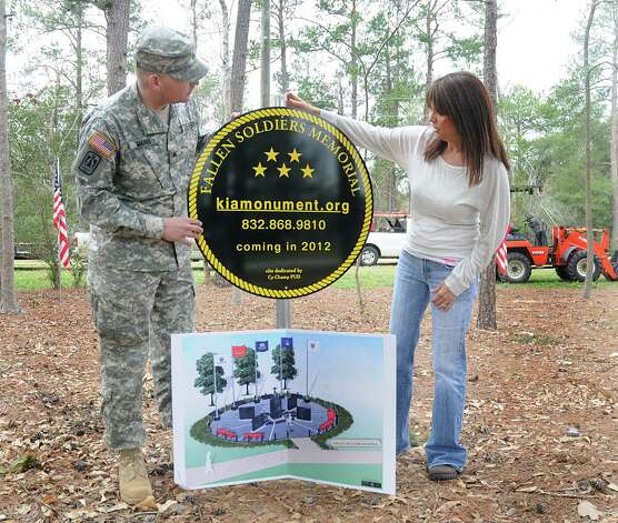 U.S. Army Sgt. Sean Mains, of Cypress Recruiting Station, and Cheryl Whitfield, of Spring, examine the marker the proposed site of the Fallen Warriors Memorial. Photo: David Hopper / freelance