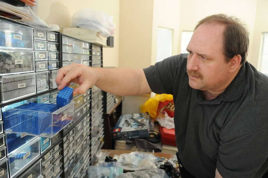 "William ""Pat"" Hough sorts through his Lego collection at his Cypress home. Hough is among area collectors who are excited about the planned April opening of the Lego store in The Woodlands. Photo: Jerry Baker"