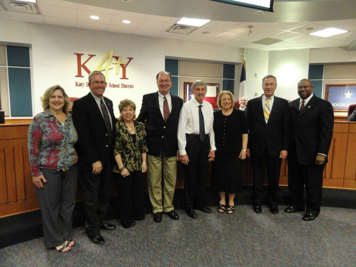 Katy Independent School District trustees recently named new schools. From left are trustee Rebecca Fox, board vice president; Fred and Patti Shafer, namesakes for Elementary No. 35; Tom Wilson, namesake for Elementary No. 33; Ray and Jamie Wolman, namesakes for Elementary No. 34; trustee Joe Adams, board president; and Katy ISD Superintendent Alton Frailey.