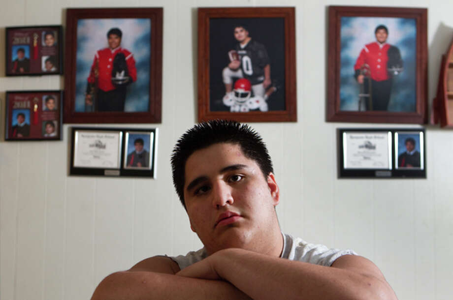 """Chris Aguilar, 16, poses for a portrait at his home Wednesday, April 4, 2012, in Huffman. During a heart screening last year, Aguilar, a football player, was flagged as """"high risk"""" for heart problems. He was diagnosed with ventricular arrhythmia, that has since been fixed with a recent surgery. """"I'm glad to be back to my normal life,"""" Aguilar said.  ( Brett Coomer / Houston Chronicle ) Photo: Brett Coomer, (Brett Coomer / Chronicle) / © 2012 Houston Chronicle"""
