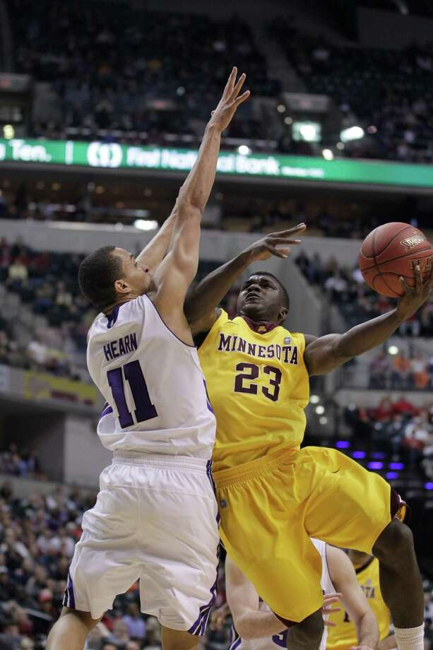 Minnesota guard Chip Armelin (23) goes up for a basket against Northwestern guard Reggie Hearn (11) in the overtime of an NCAA college basketball game at the first round of the Big Ten Conference tournament in Indianapolis, Thursday, March 8, 2012. (AP Photo/Michael Conroy) Photo: Michael Conroy, STF / AP