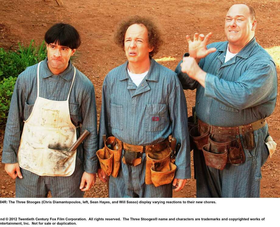 The Three Stooges (Chris Diamantopoulos, left, Sean Hayes, and Will Sasso as Moe, Larry and Curly) display varying reactions to their new chores. Photo: 20th Century Fox / TM and © 2012 Twentieth Century Fox Film Corporation.  All rights reserved.  The Three Stooges® name and characters are trademarks and copyrighted works of C3 Entertainment, Inc.  Not for sale or duplication.