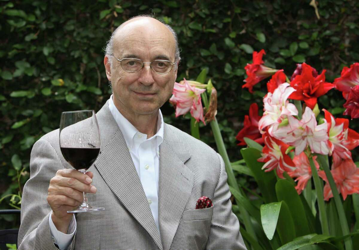 (For the Chronicle/Gary Fountain, April 4, 2012) Denman Moody enoying a glass of wine on the patio of his home.