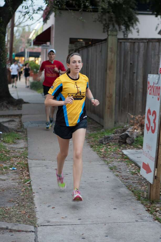 Melanie Holeman finishes a lap at the running club's weekly meeting. Photo: R. Clayton McKee / © R. Clayton McKee