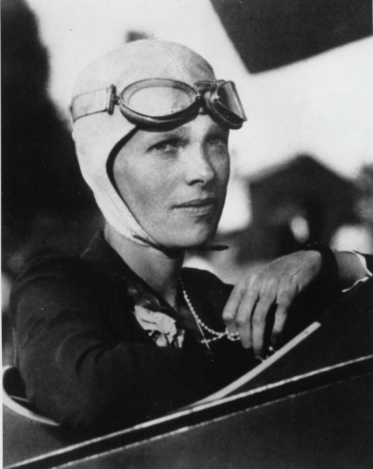 An undated file photo shows Amelia Earhart, the first woman to fly solo across the Atlantic Ocean.   Secretary of State Hillary Rodham Clinton is meeting Tuesday March 20, 2012,  with historians and scientists from The International Group for Historic Aircraft Recovery, which will launch a new search in June for the wreckage of Earhart's plane off the remote island of Nikumaroro. Photo: Anonymous, HO / AP2007