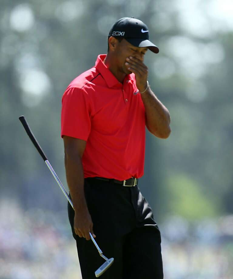 Tiger Woods reacts to missing his birdie putt on No. 1 during the Masters at the Augusta National Golf Club in Augusta, Georgia, Sunday, April 8, 2012. (Curtis Compton/Atlanta Journal-Constitution/MCT Photo: Curtis Compton, McClatchy-Tribune News Service