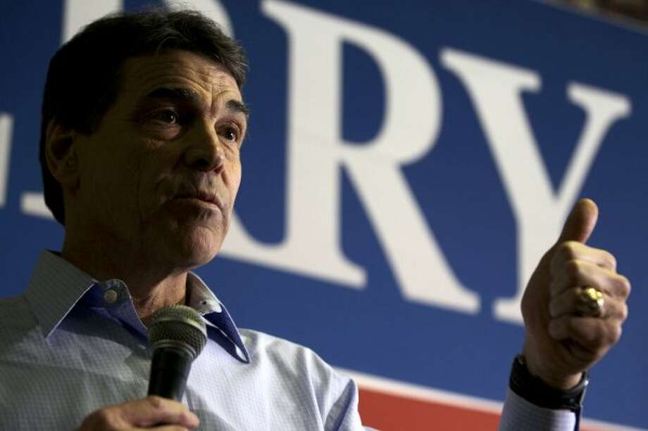 "Perry received some criticism after it became known that he ""retired"" in 2011, and started collecting pension benefits. (David Goldman / Associated Press)"