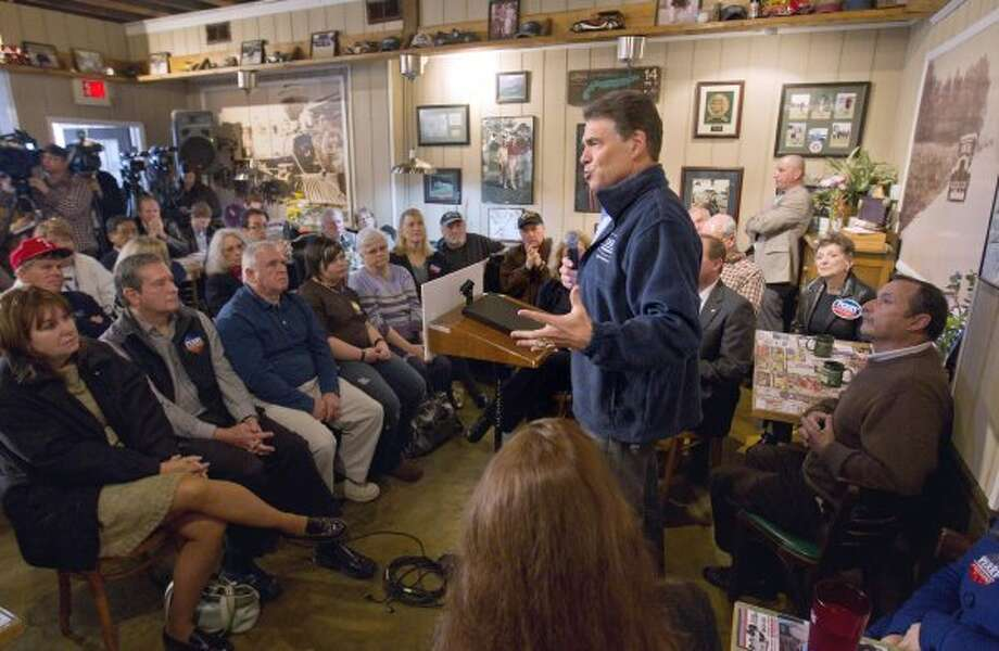 At a November 2011 town hall meeting in Goffstown, N.H., Perry got both the election date and voting age wrong when talking to university students. (David Goldman / Associated Press)