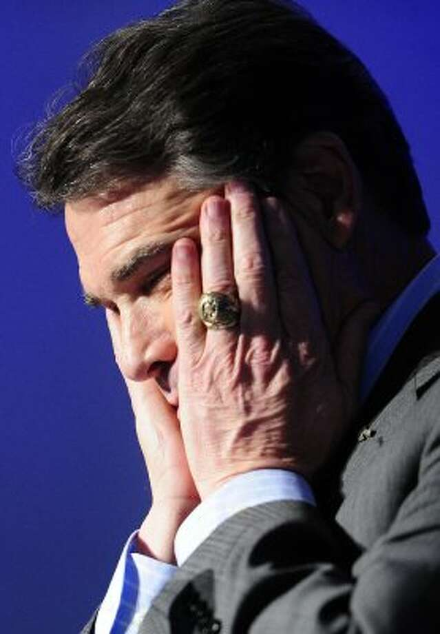 """Oops!"" The mistake heard across the country as Perry failed to name one of the federal agencies he would eliminate if elected. (EMMANUEL DUNAND / AFP/Getty Images)"
