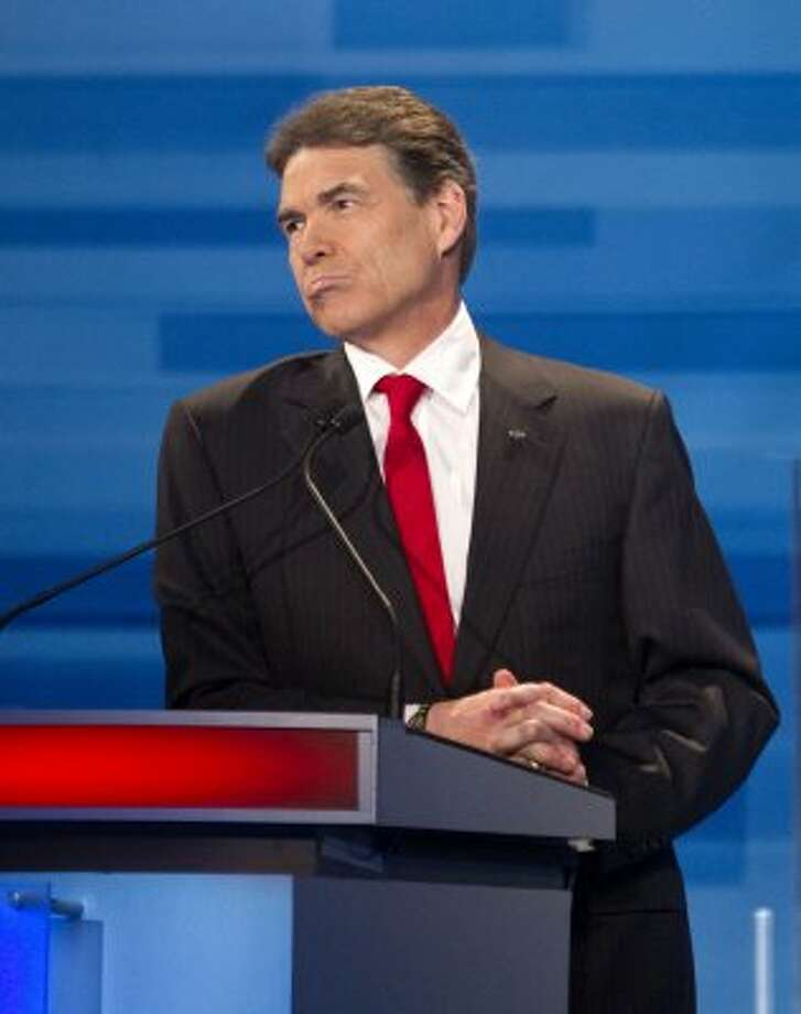 In a New Hampshire GOP debate, Perry said he would send troops back to Iraq, drawing criticism. (David Goldman / Associated Press)
