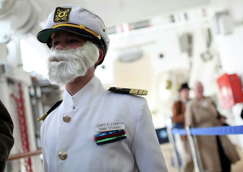 Patrick Druckenmiller wears a costume depicting Titanic Captain Edward John Smith as he waits in line to board the Azamara Journey with his grandmother Stephanie Hayes on April 10, 2012 in New York City.  The Azamara Journey will embark from New York to continue on the Titanic Memorial Cruise to memorialize the 100th anniversary of the Titanic's fateful voyage. Photo: Justin Sullivan, Getty Images / 2012 Getty Images