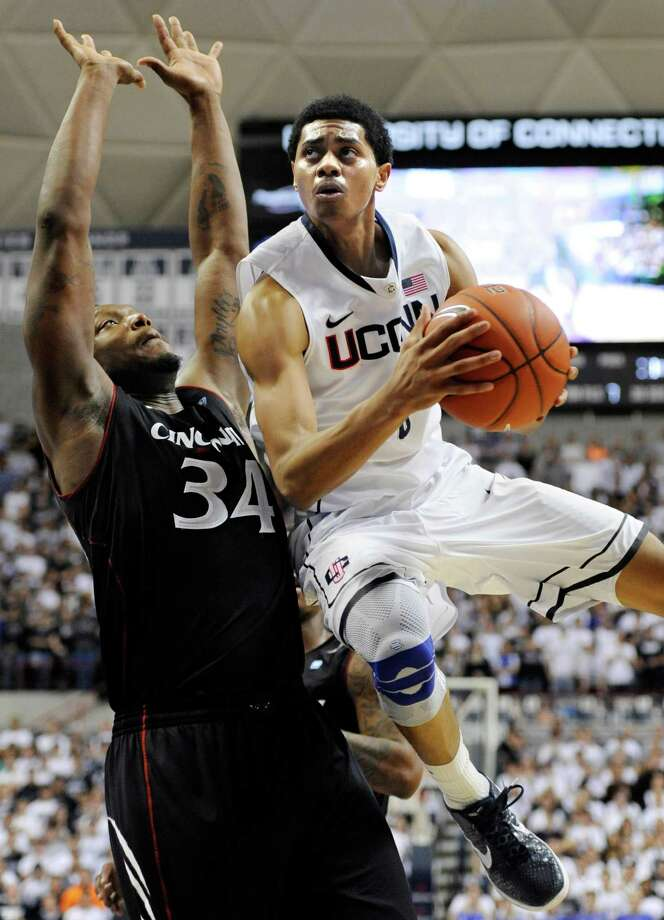 FILE - In this Jan. 18, 2012 file photo, Connecticut's Jeremy Lamb, right, drives to the basket while guarded by Cincinnati's Yancy Gates (34) in the second half of an NCAA college basketball game in Storrs, Conn.  Lamb has declared for the NBA draft. Lamb said in a statement released Tuesday, April 10, 2012,  by UConn that it was a difficult decision to go professional but it is in the best interest of his family.  (AP Photo/Jessica Hill, File) Photo: Jessica Hill, Associated Press / AP2012