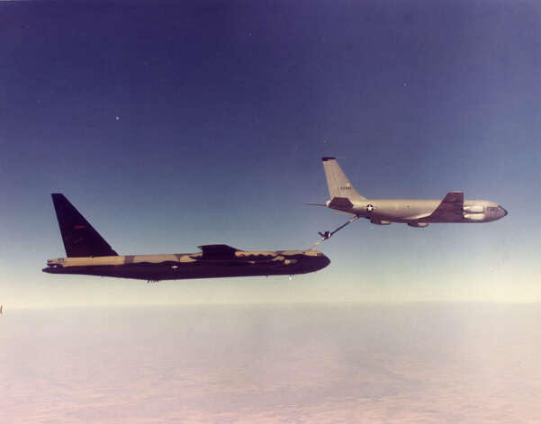 A B-52 refuels from a Boeing KC-135 Stratotanker over Southeast Asia  during the Vietnam War. Photo: U.S. Air Force / SL