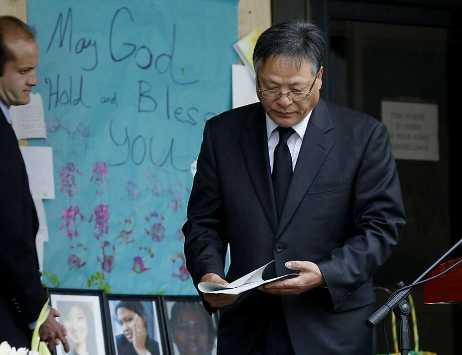 Oikos University president Jongin Kim left the podium after speaking at the memorial. A memorial service was held in the rain for the seven victims of Oikos University at the campus where the shooting occurred in Oakland, Calif. Tuesday April 10, 2012. Photo: Brant Ward, The Chronicle