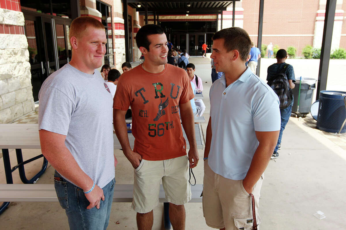 Johnson High School Senior football players, Austin Carson, 18, Cohner Mokry, 17, Ryder Burke, 18, participate in a program to reduce bullying at the school.