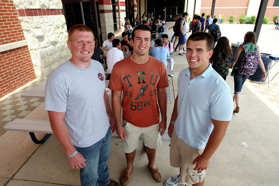 Johnson High School Senior football players, Austin Carson, 18, Cohner Mokry, 17, Ryder Burke, 18, participate in a program to reduce bullying at the school. Photo: Jerry Lara, Jerry Lara/Express-News / © San Antonio Express-News