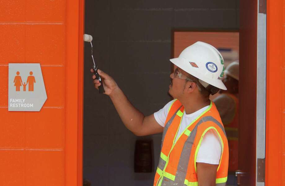 Francisco Murillo paints a doorway at the BBVA Compass Stadium, Tuesday, April 10, 2012, in Houston. Photo: James Nielsen, Chronicle / © 2012 Houston Chronicle