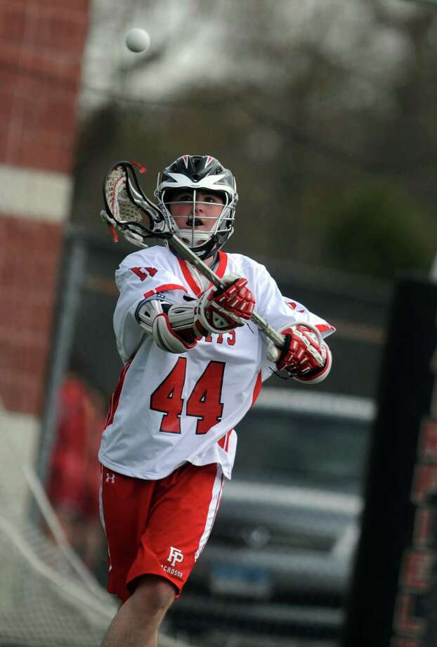 Fairfield Prep's Jack Arrix passes the ball during their match against Cheshire Tuesday, April 10, 2012 at Alumni Field on the campus of Fairfield University. Photo: Autumn Driscoll / Connecticut Post