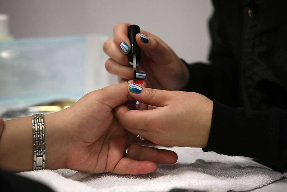 Student Christine Nguyen from Oakland doing the nails of Nini Trinh at Laney College School of Cosmetology in Oakland, Calif.,  on Tuesday, April 10, 2012. Photo: Liz Hafalia, The Chronicle