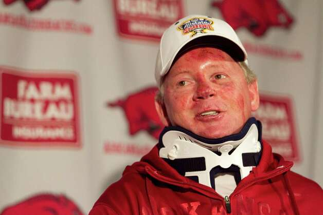 Arkansas football coach Bobby Petrino speaks during a news conference at a Fayetteville, Ark., on Tuesday, April 3, 2012, after being released from a hospital after he was injured in a motorcycle accident on Sunday, April 1. The 51-year-old says he was not wearing a helmet at the time of the crash, which occurred on Arkansas Highway 16 in Madison County _ about 20 miles southeast of Fayetteville. State law does not require an adult rider wear a helmet. (AP Photo/Gareth Patterson) Photo: Gareth Patterson, FRE