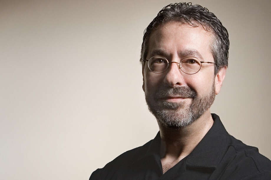 "Austin resident Warren Spector leads the studio responsible for the upcoming video game, ""Epic Mickey."" He's also working on his second novel. Photo: Unknown / DirectToArchive"