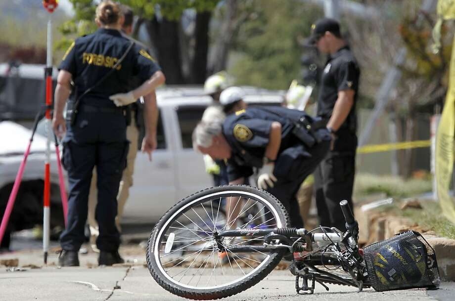 One of the three bicycles, as the investigation of the scene continues after as a 17-year-old male driver is being charged with manslaughter when the vehicle he was driving hit 3 bicyclists on Treat Blvd. at Oak Grove in Concord, Ca. killing a father, Soliaman Nuri, and his 9-year-old daughter Hadesa Nuri, and leaving a second daughter, a 12-year-old with minor injuries, on Saturday April 7, 2012. Photo: Michael Macor, The Chronicle