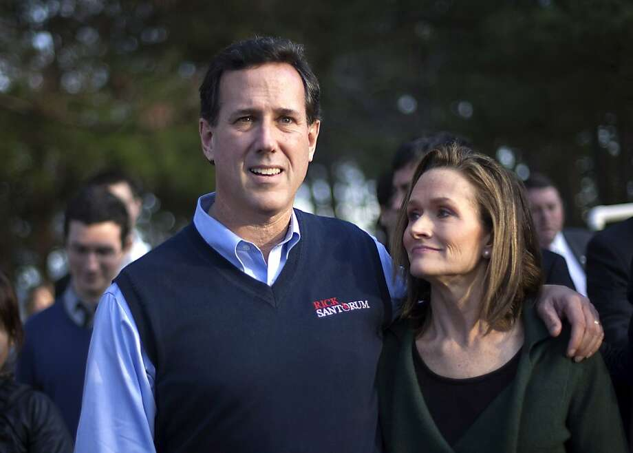 FILE - In this Jan. 16, 2012, file photo Republican presidential candidate, former Pennsylvania Sen. Rick Santorum and his wife Karen leave the Faith and Freedom Coalition rally in Myrtle Beach, S.C.    Santorum plans no campaign events on Monday April 9, 2012 and will spend time with his wife and ailing daughter Bella.  (AP Photo/David Goldman/file) Photo: David Goldman, Associated Press