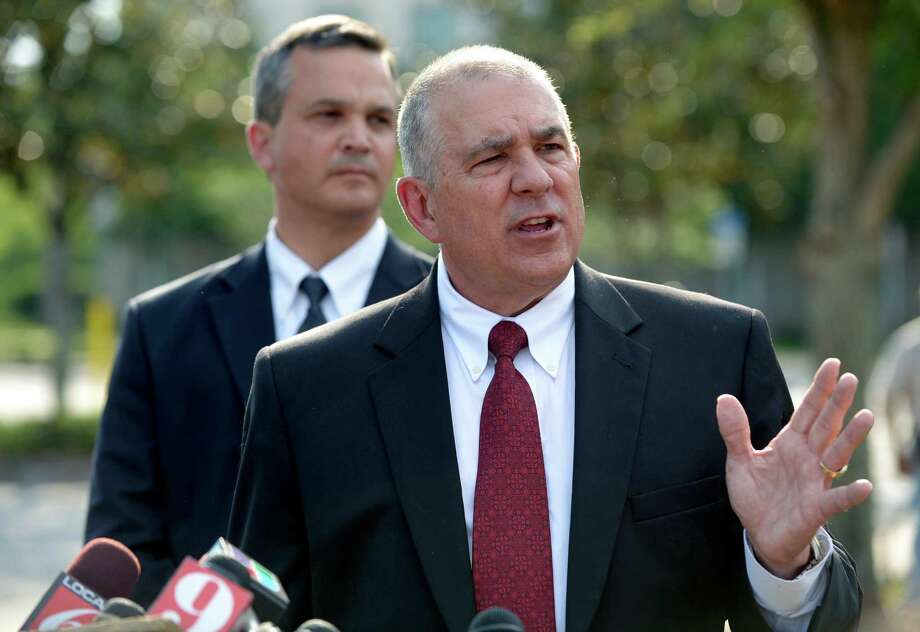 Hal Uhrig, right, and Craig Sonner, former attorneys for George Zimmerman, speak to reporters during a news conference to announce that both attorneys had quit as Zimmerman's legal representatives in Sanford, Fla., Tuesday, April 10, 2012. Zimmerman is a neighborhood watch volunteer who authorities say fatally shot an unarmed teenager. The men said have withdrawn as his counsel because they haven't heard from him in days and he is taking actions related to the case without consulting them. (AP Photo/Phelan M. Ebenhack) Photo: Phelan M. Ebenhack