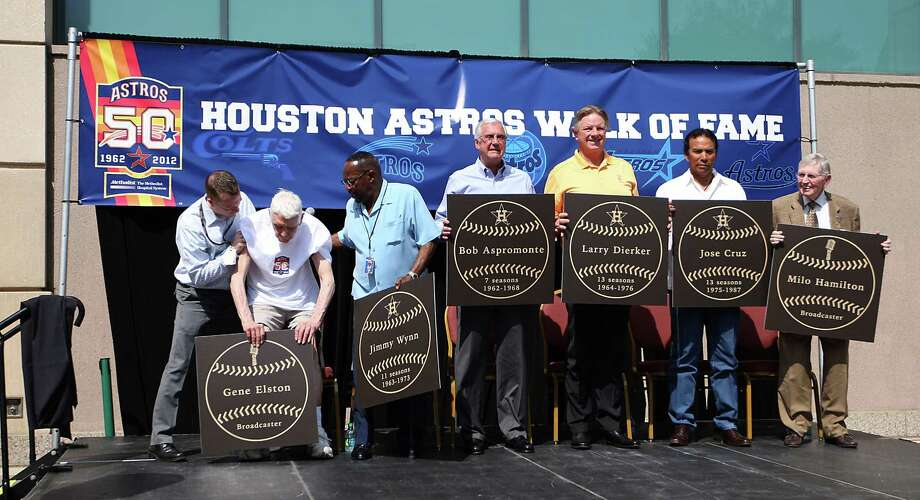 Fomer Astros broadcaster Gene Elston gets assistance during the group photo with Jimmy Wynn, Bob Aspromonte, Larry Dierker, Jose Cruz, and Milo Hamilton during the Walk of Fame ceremony at Minute Maid Park Tuesday, April 10, 2012, in Houston. Hall of Fame broadcasters Milo Hamilton and Gene Elston and former Colt .45s/Astros star Bob Aspromonte were among the first to be officially inducted into the new Astros Walk of Fame, which is located outside of Minute Maid Park on the Texas Ave. sidewalk. Photo: Karen Warren, Houston Chronicle / © 2012  Houston Chronicle