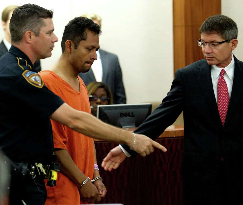 Carlos Alvarado is charged with murder, accused of choking his wife, Isabel Alvarado, to death and then dismembering her body and burning it. Photo: Brett Coomer / © 2012 Houston Chronicle