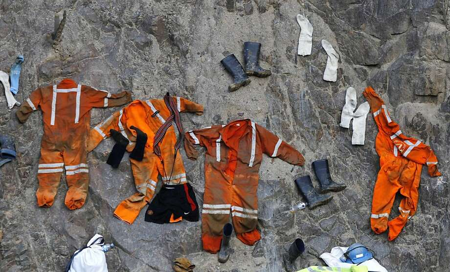 Clothing used by miners dry on a rock wall outside the entrance of the Cabeza de Negro gold-and-copper mine where some miners are trapped in Yauca del Rosario, Peru, Tuesday April 10, 2012. Authorities say nine miners trapped inside the wildcat mine since April 5 are being supplied with sports drinks, soup and food while emergency responders work to free them.  (AP Photo/Martin Mejia) Photo: Martin Mejia, Associated Press