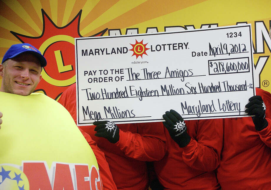 1. $656.0 million, Mega Millions, March 30, 2012 (3 tickets from Kansas, Illinois and Maryland). The three anonymouswinners of the Maryland portion of the Mega Millions, joined by a state lottery worker, show off their winnings in Baltimore. / Maryland State Lottery Agency