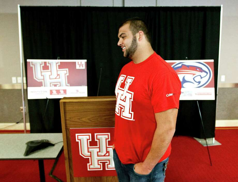 UH defensive lineman Ameen Behbahani is one of the first to wear one of the school's new logos. Photo: Nick De La Torre / © 2012  Houston Chronicle