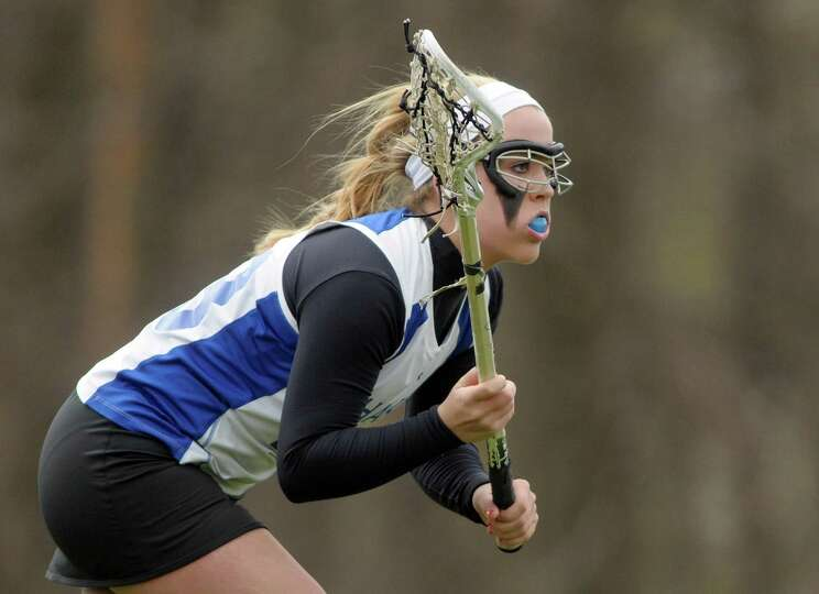 Shaker High School girls lacrosse player Maddie Devine gets set to move in on a faceoff during their
