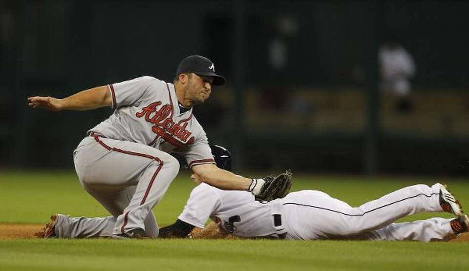 Atlanta's Dan Uggla (26) tries to tag out Astros center fielder Jordan Schafer, who beat the tag. (K