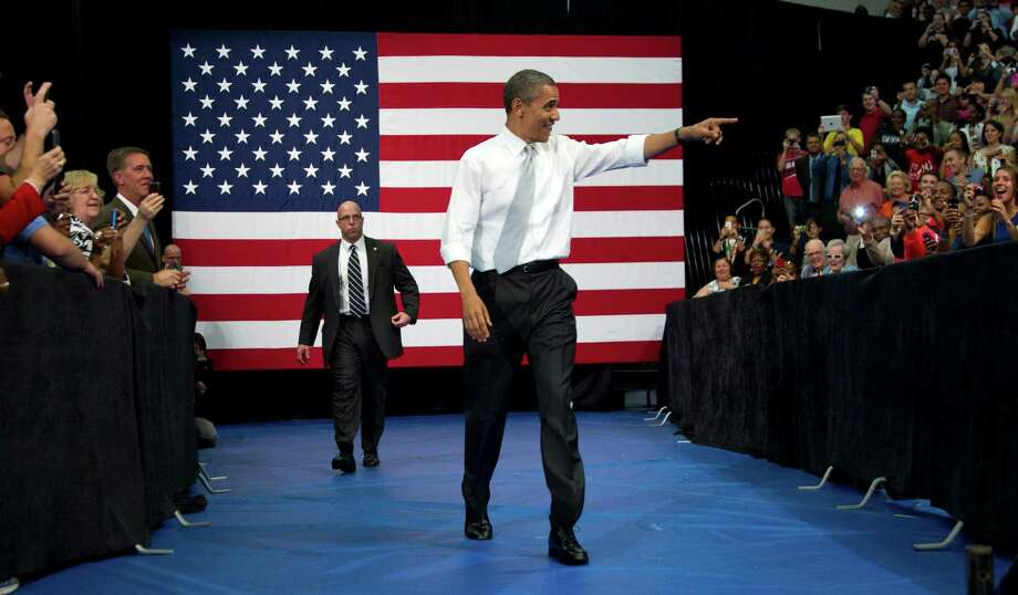 President Barack Obama gesturesas he arrives to speaks at Florida Atlantic University, Tuesday, April 10, 2012, in Boca Raton, Fla. (AP Photo/Carolyn Kaster) Photo: Carolyn Kaster