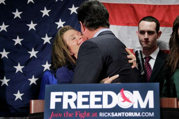Former Pennsylvania Sen. Rick Santorum gets a hug from his wife Karen after announcing he is suspending his candidacy for the presidency, Tuesday, April 10, 2012, in Gettysburg, Pa.  (AP Photo/Gene J. Puskar) Photo: Gene J. Puskar