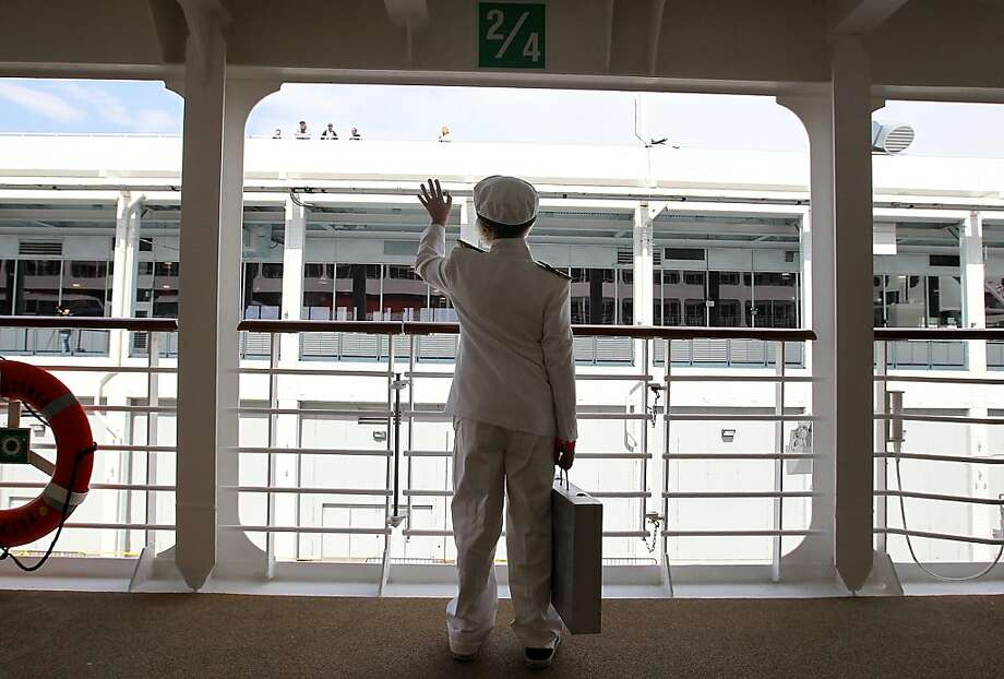 NEW YORK, NY - APRIL 10:  Patrick Druckenmiller wears a costume depicting Titanic Captain Edward John Smith as he waves to family members from the deck of the Azamara Journey on April 10, 2012 in New York City.  The Azamara Journey will embark from New York to continue on the Titanic Memorial Cruise to memorialize the 100th anniversary of the Titanic's fateful voyage. The cruise began in Southampton, England and will continue on with onbaord lectures and a memorial at sea when the Titanic sank.  (Photo by Justin Sullivan/Getty Images) *** BESTPIX *** Photo: Justin Sullivan, Getty Images
