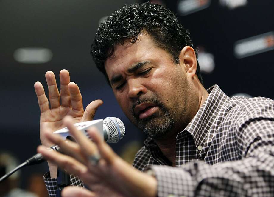 Miami Marlins manager Ozzie Guillen gestures at a news conference at Marlins Stadium in Miami, Tuesday April 10, 2012. Guillen has been suspended for five games because of his comments about Fidel Castro. He has again apologized and says he accepts the punishment. Photo: Lynne Sladky, Associated Press