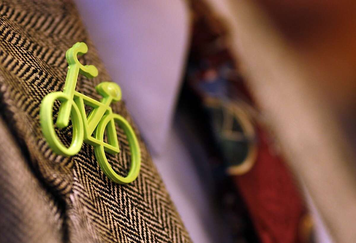 Bert Hill, chair of the Bicycle Advisory Committee, wears a bicycle pin and tie during a meeting where Board of Supervisors President David Chiu and other city leaders announced new efforts to improve street safety for pedestrians, bicyclists and drivers at City Hall in San Francisco, Calif. on April 10, 2012.