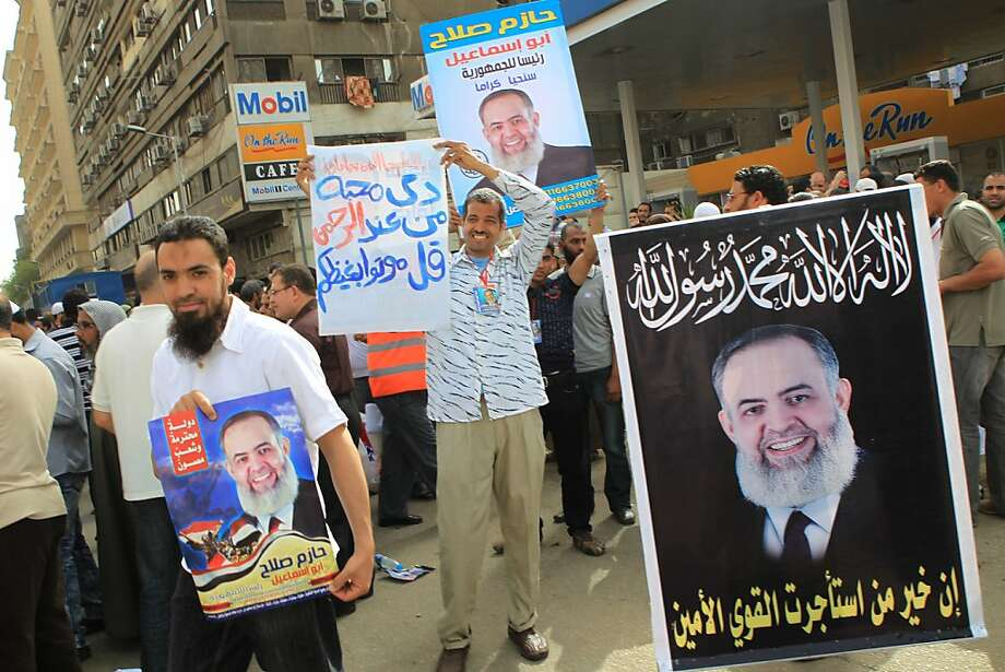 Egyptian Islamist protesters hold up portraits of Salafist presidential candidate Hazem Abu Ismail during a rally outside the State Council court in Cairo on April 10, 2012. The Egyptian administrative court suspended the Islamist-dominated commission tasked with drafting a new constitution amid a boycott by liberals, moderate Muslims and the Coptic church while a provisional list of candidates includes former Arab League chief Amr Mussa, ultra-conservative Islamist preacher Hazem Abu Ismail, the Muslim Brotherhood's Khairat El-Shater, former Brotherhood member Abdel Moneim Abul Fotouh, Mubarak's last prime minister, Ahmed Shafiq, and former intelligence chief Omar Suleiman. Photo: Khaled Desouki, AFP/Getty Images